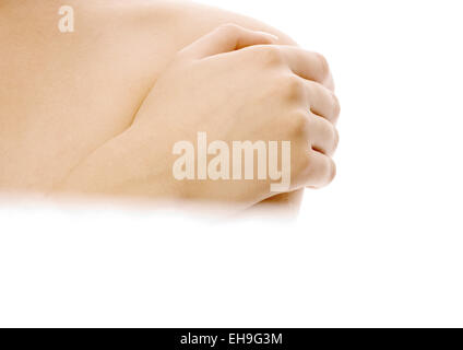 Woman with hand on bare shoulder, close-up - Stock Photo