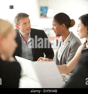 Businesspeople at meeting - Stock Photo