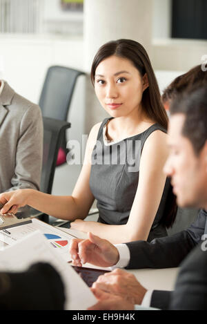 Businesswoman at corporate meeting - Stock Photo