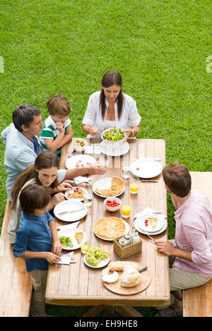 Family and friends gather for weekend picnic - Stock Photo