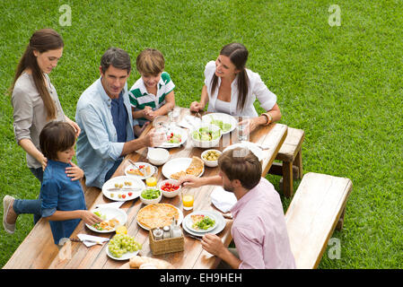Family and friends gather for picnic - Stock Photo