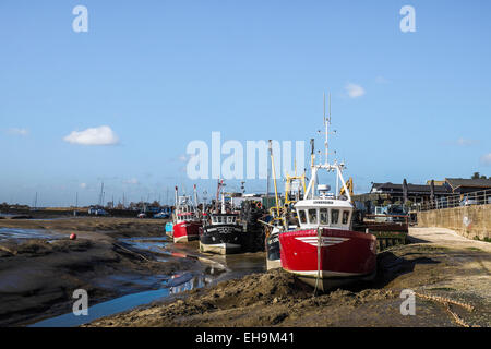 Cockle boats tied up at low tide at Leigh on Sea in Essex. - Stock Photo
