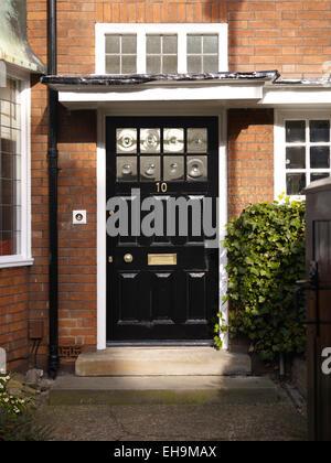 Traditional Black front door of redbrick house, Kingsmead, UK - Stock Photo