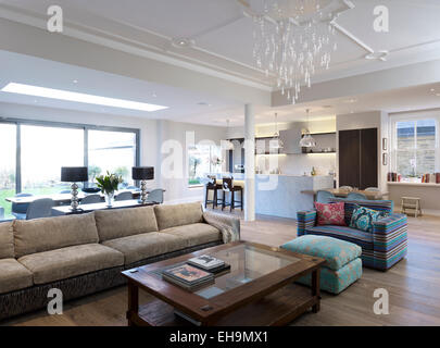 Seating area with sofas and coffee table in large open plan room, residential house, Thurleigh Road, Clapham, London, - Stock Photo