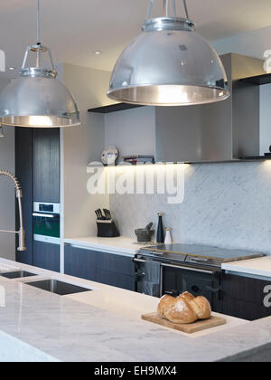 pendant lamps above island unit in modern kitchen residential house thurleigh road clapham - Modern Kitchen Lamps