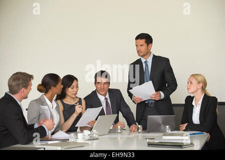 Executive giving presentation in meeting - Stock Photo