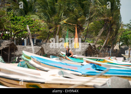 Fishing Boats & Fisherman huts,Arugam bay, Sri Lanka, Asia - Stock Photo