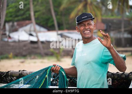 Fishermen on a beach, Arugam Bay, Sri Lanka, Asia - Stock Photo