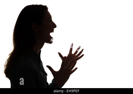 profile of screaming woman in silhouette - Stock Photo