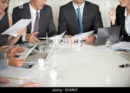 Business associates brainstorming in meeting - Stock Photo