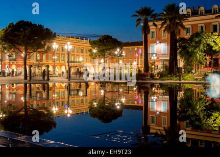 water area with fountains, mist and then calmness which creates reflections on the still water, Place Massena, Nice, - Stock Photo