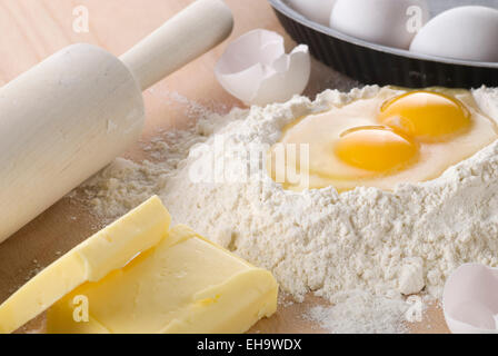 Baking ingredients. Flour, egg and butter. - Stock Photo