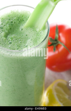 Fresh green smoothie, made from green vegetables. - Stock Photo