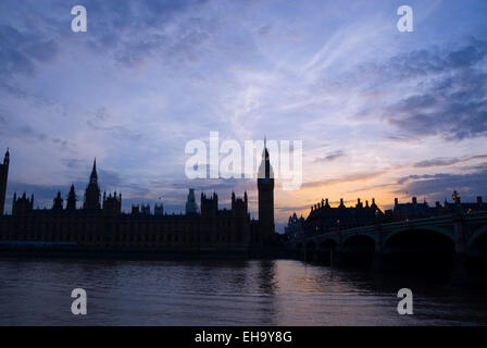 London 21 Aug 2013 : Westminster Palace and Big Ben in silhouette at sunset, River Thames, London, UK - Stock Photo