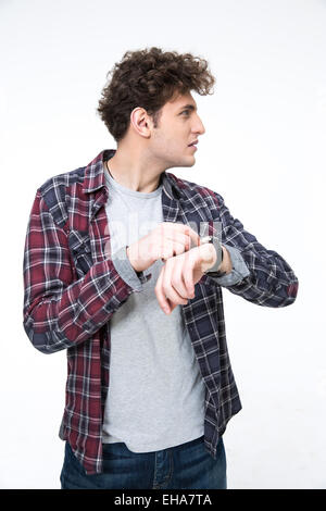 Portrait of a young man with wristwatch looking away - Stock Photo