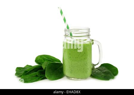 Healthy green smoothie with spinach in a jar mug isolated on white - Stock Photo