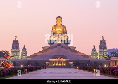 Kaohsiung, Taiwan - December 15, 2014: Sunset at Fo Guang Shan, the biggest buddist temple of Kaohsiung in Taiwan, with a buddhi Stock Photo