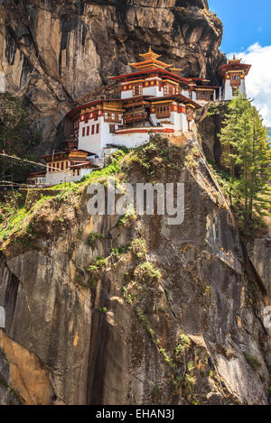 Taktshang Goemba or Tiger's nest temple located in the cliffside of Paro valley in Bhutan - Stock Photo