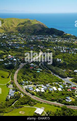 North Island Main Trunk Railway Line at Pukerua Bay, Wellington region, North Island, New Zealand - aerial - Stock Photo