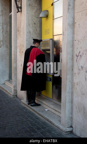 Carabiniere, Italian policeman withdrawing money, cash from ATM machine in bank. Rome, Roma, Italy, Italia, Vatican - Stock Photo