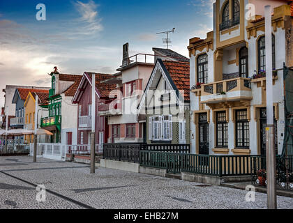 Costa Nova do Prado ( Portugal) famous home Palheiros with their houses with colorful stripes derived from original - Stock Photo