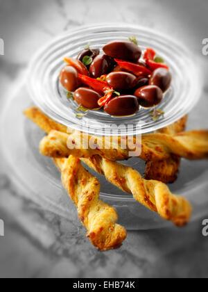 Kalamata olives an bread sticks snack - Stock Photo