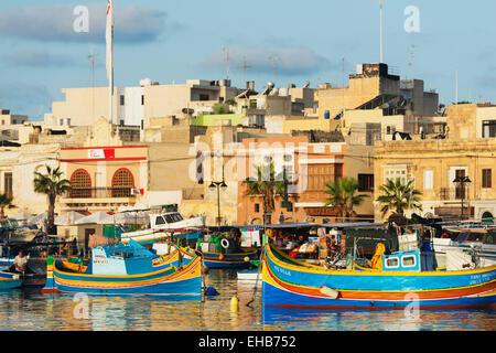 Mediterranean Europe, Malta, Marsaxlokk harbour, colourful fishing boats (dghajsa) - Stock Photo