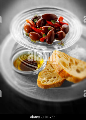 Kalamate olives and bread with dipping oil - Stock Photo