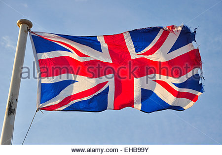 A union Jack Flag flying in the breeze. - Stock Photo
