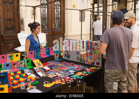 Argentina, Buenos Aires, San Telmo, Defensa, street market stall selling painted wooden toys - Stock Photo