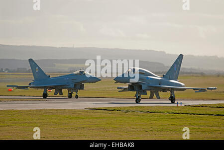Eurofighter Typhoons ZK379 (EX) and ZK334 (FB) preparing for line up on RAF Lossiemouth runway 23, Moray. Scotland. - Stock Photo