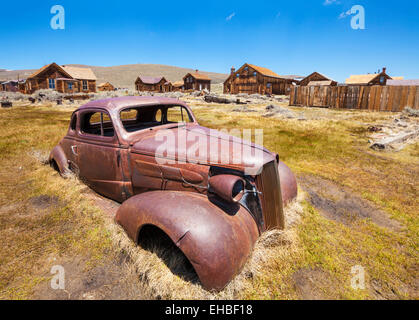 Rusting car in Bodie ghost town Bodie State Historic Park California USA United States of America - Stock Photo