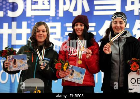 Yabuli town, Heilongjiang, China. 11th March, 2015. Gold medalist Natalia Soboleva (C) of Russia, silver medalist - Stock Photo