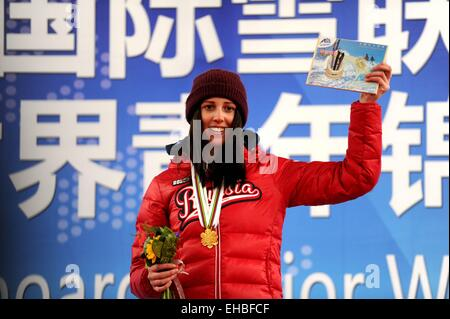 Yabuli town, Heilongjiang, China. 11th March, 2015. Gold medalist Natalia Soboleva of Russia poses during the awarding - Stock Photo