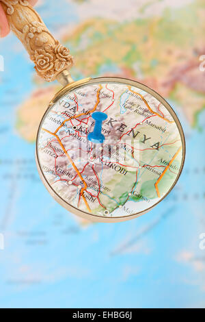 Blue tack on map of Africa with magnifying glass looking in on Nairobi, Kenya - Stock Photo