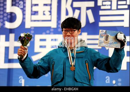Yabuli Town, China. 11th March, 2015. Gold medalist Lee Sang-Ho of South Korea poses during the awarding ceremony - Stock Photo