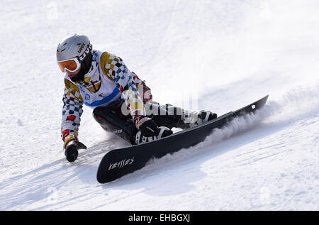 Yabuli Town, China. 11th March, 2015. Dmitry Sarsembaev of Russia competes during the Men's Giant Slalom match on - Stock Photo