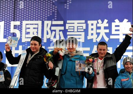Yabuli Town, China. 11th March, 2015. Gold medalist Lee Sang-Ho (C) of South Korea, silver medalist Dario Caviezel - Stock Photo
