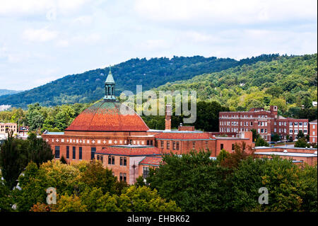 Asheville North Carolina, First Baptist Church aerial view with mountains in the background - Stock Photo