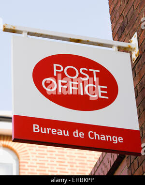 Business, Finance, Money, Post Office Bureau de Change foreign exchange sign on the wall of a Post Office building. - Stock Photo