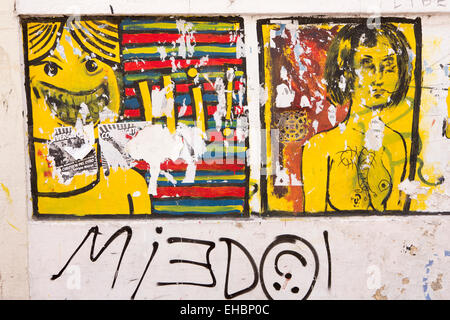 Argentina, Buenos Aires, San Telmo, remnants of fly posters torn over wall graffiti - Stock Photo