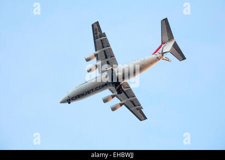 CityJet EI-RJU Cityjet British Aerospace Avro RJ85 plane flying overhead towards London City Airport - Stock Photo