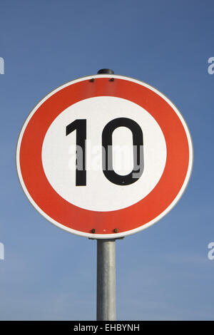 a german speed limit sign outdoors - Stock Photo