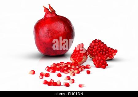 Pomegranate detail fruit isolated on white background - Stock Photo