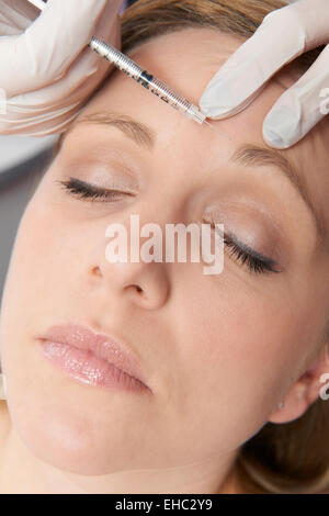 Woman Having Botox Injection In Forehead