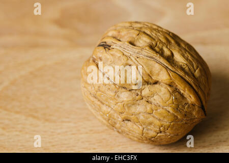 walnut on wooden background closeup macro texture - Stock Photo
