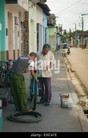 Cuba Sancti Spiritus street road side scene bike bicycle pedal cycle repair service shop store - Stock Photo