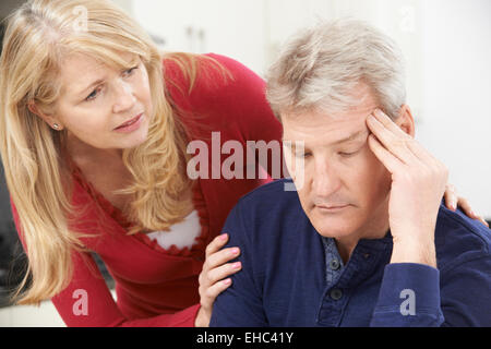 Mature Woman Comforting Man With Depression - Stock Photo