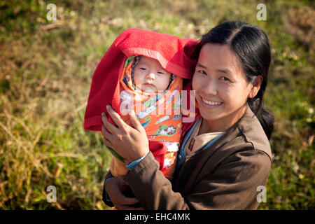 A Burmese mother with her baby child, Myanmar, ( Burma ), Asia - Stock Photo