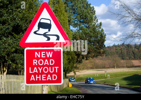 New Road Layout Ahead and Risk of Skidding Road Signs, UK - Stock Photo